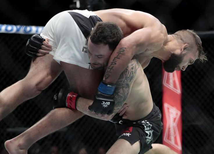 Frankie Edgar lifted Jeremy Stephens during a featherweight bout at UFC 205 at Madison Square Garden.