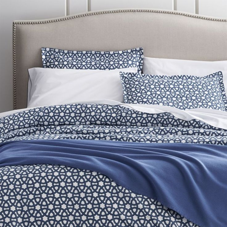 Shop Union Square Duvet Cover and Pillow Shams.  Inspired by New York City's Union Square, designer Chris Mestdagh invokes the location's hustle and bustle in dynamic pattern of intersecting circles in vibrant blue.