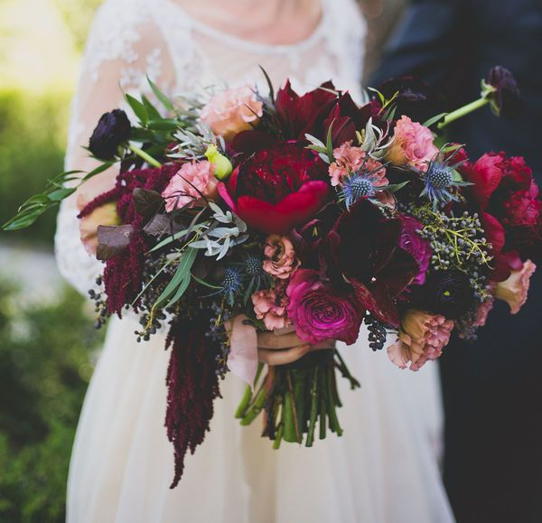 Rich Colors: Pale, muted flowers are never going to go out of style for weddings. Appropriate for any season, this bold bridal bouquet full of rich layers of colors looks stunning in photos.