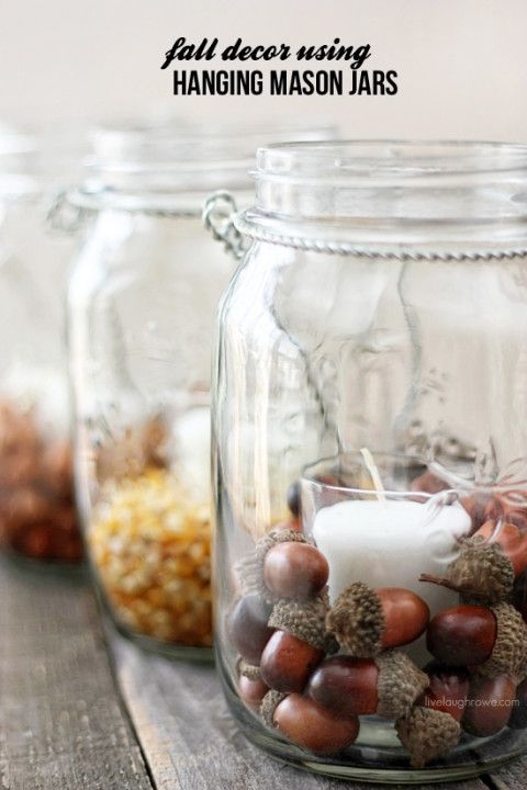 Inexpensive Pottery Barn inspired decoration. Using hanging mason jars and fillers, you can create fabulous fall decor in minutes!