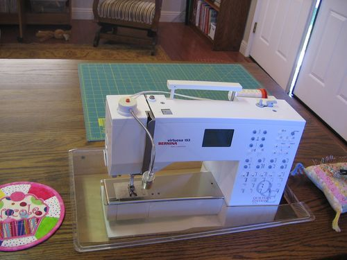 Dinning table with a cut out to create a flush sewing surface.