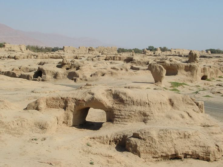 The 7th century city of Gaochang covers a wide area southeast of Turpan, Xinjiang, China. As recently as a century ago local farmers mined the ruins for soil and used the wall paintings as fertilizer.