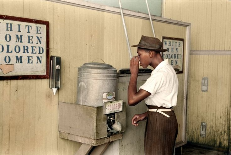 Young Man Drinking From Colored Water Fountain (1939)