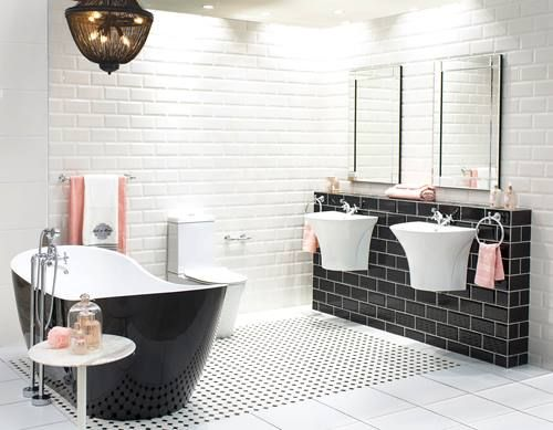 Transform your bathroom into a luxurious space with brave Black colour schemes and Décor-trending white extras.