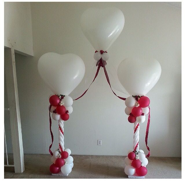 Nice idea for a wedding balloon column...connect the two columns with a large floating heart.