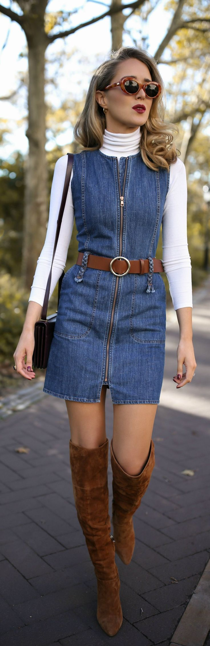 Sleeveless zip-up denim dress, white layering turtleneck, brown suede over-the-knee boots, brown leather circle belt, burgundy handbag, burgundy leather moto jacket with faux fur and cat eye sunglasses {See by Chloe, YSL, Three Dots, classic fall style, fall winter 2017, fall bonfire, classic dressing, fashion blogger, street style}