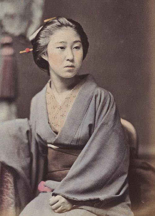 Hand-colored photo-portrait of a sitting woman in kimono.   Circa 1880's, Japan by photographer Kozaburo Tamamura. S)