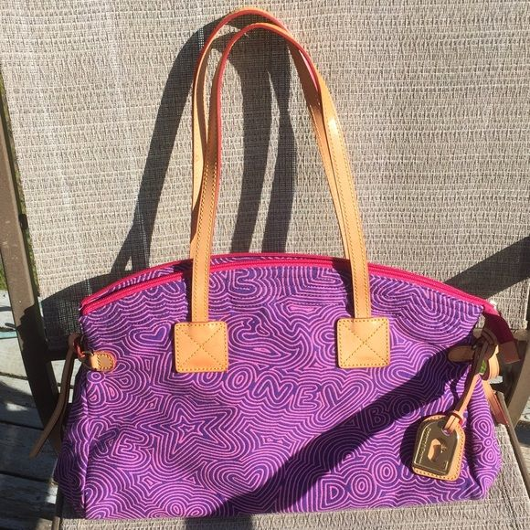 Dooney&Bourke signature XL bag!Perfect; like new! Beautiful pink cloth handbag, nylon interior, leather straps and accents. Dooney & Bourke Bags