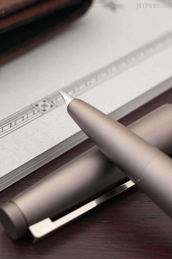 The special-edition Black Amber Lamy 2000 Fountain Pen marries sleek style with an immaculate satin finish, spring-loaded clip, and luxuriously smooth 14k gold nib.