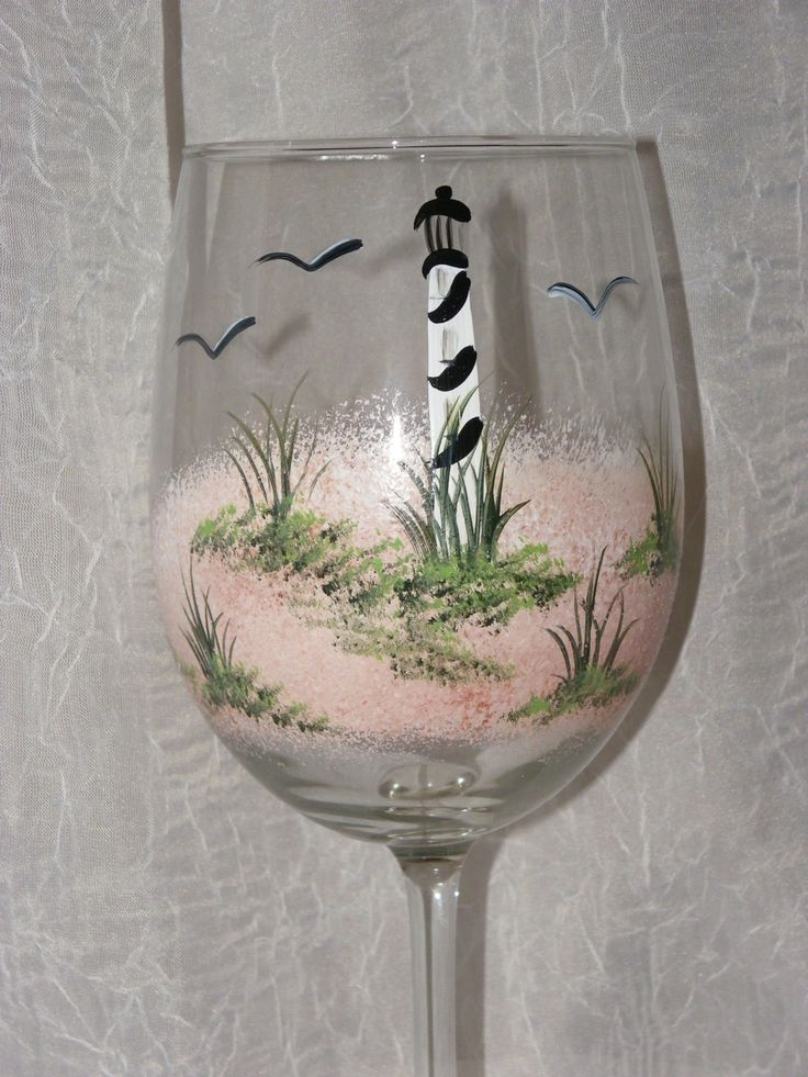 18 oz. white, high quality, hand painted wine glasses. This design is a lighthouse on sandy dunes. Glasses are all dishwasher safe (on the upper