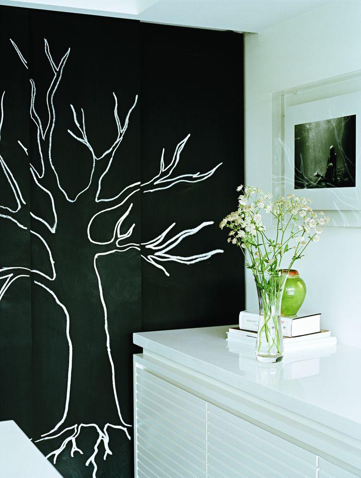 Blackboard doors in kitchen hide fridge and pass through to laundry. Brooke Aitken Design
