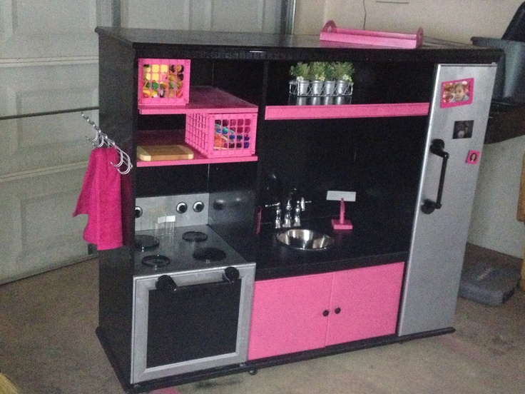 Our diy play kitchen out of an old entertainment center for Kitchen set pinterest