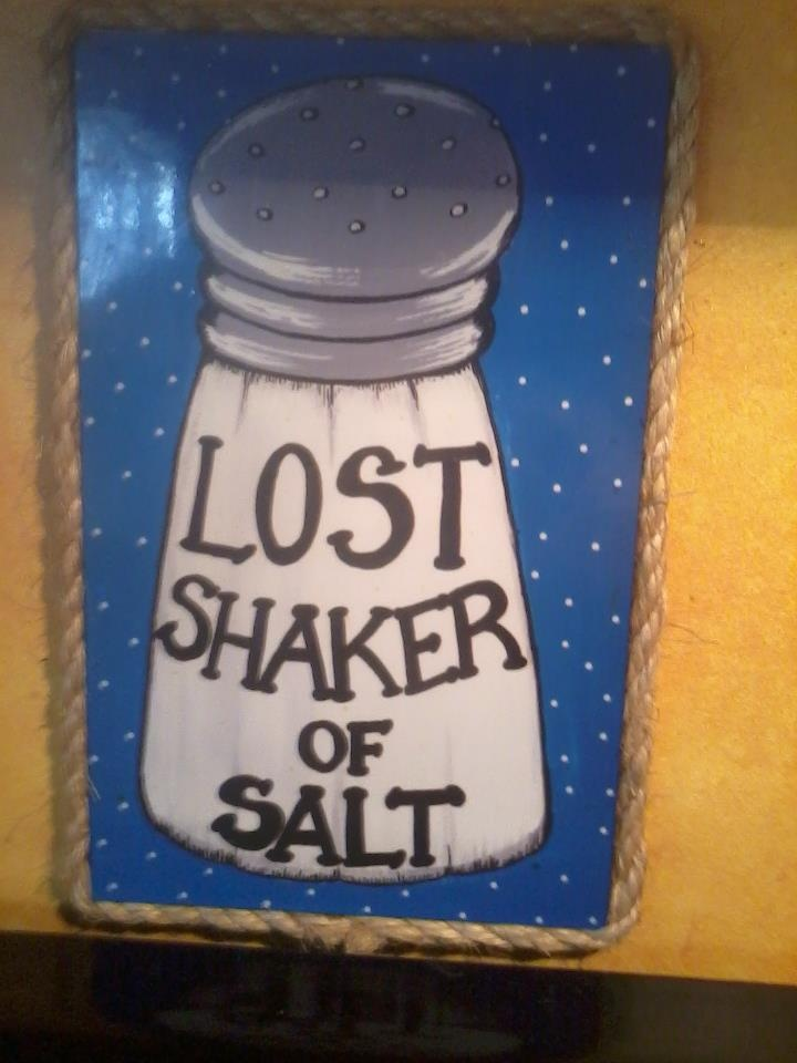 Jimmy Buffett....I actually have this! It's hanging in my loo! Why there... no idea! J