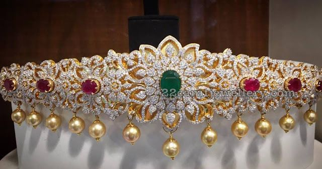 Beautiful floral design diamond, emerald,ruby armlet.I will never take it off my arm.My most complimented & admired jewelary by men & women.