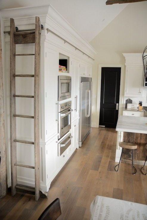 provide a space to dock library ladder against side of upper cabinet when not tall kitchen - High Kitchen Cabinets
