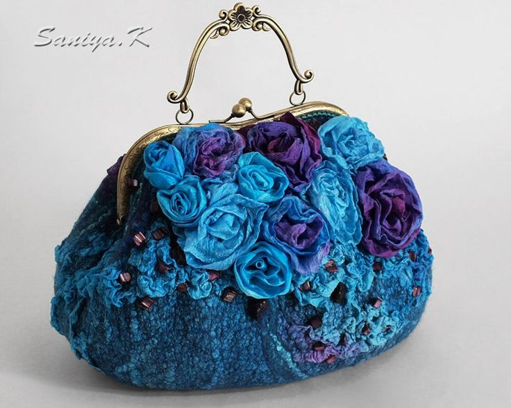 """Handbag fashion """"Fantasy"""" felted by SaniyaK on Etsy. The fashion handbag is made of wool in the technique of """"Nuno-felting"""" in the turquoise-azure-violet tones. Natural silk is felted on wool, silk roses, sari yarn, silk fibers. Embroidered with beads of pearl. The handbag closes on the frame lock (clasp) with a metal handle. Inside lining with pockets: on the """"lightning"""", open and for phone. Bottom of a tight with metal legs…"""