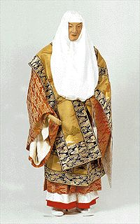 Buddhist priest in ceremonial vestment. With ho-mo (=robe) and shichijo-gesa (=seven-paneled Buddhist surplice).