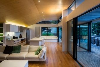 The angled roof is an important aspect of the room, throwing light through the space