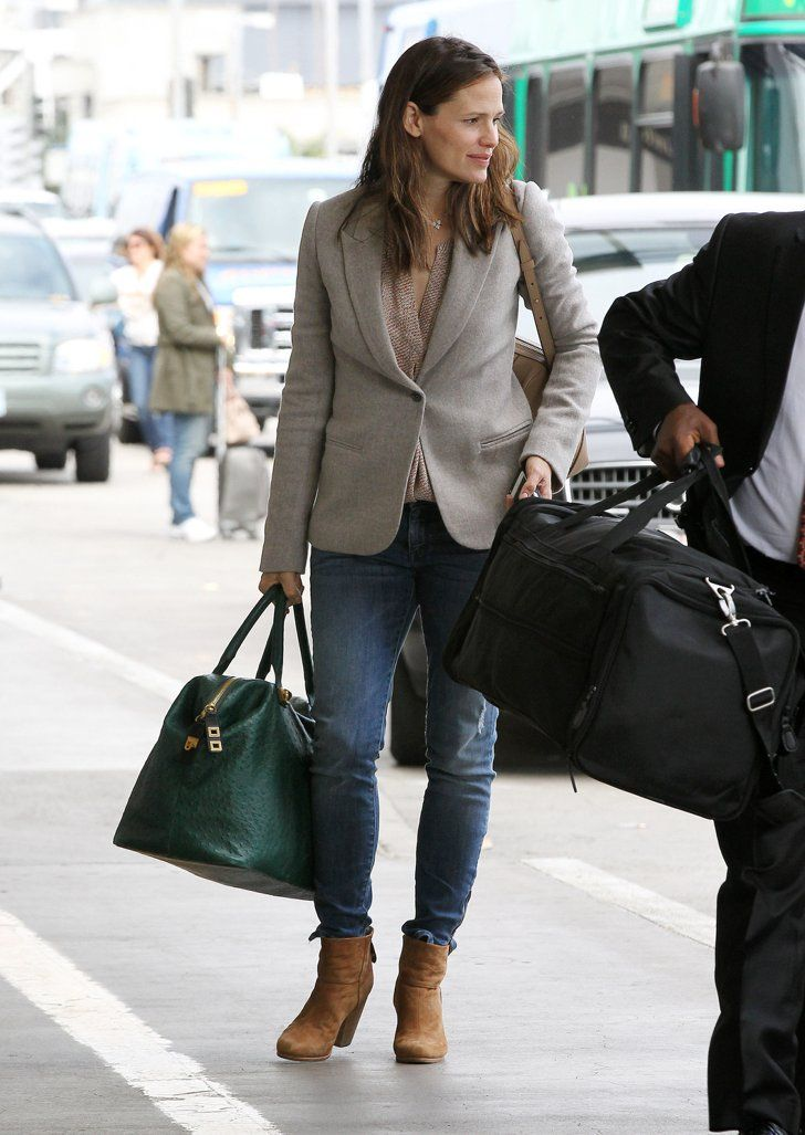 Pin for Later: 91 Style Tips to Steal From the Airport's Best Dressed Celebs  Jennifer Garner played it preppy when heading to catch her flight, mixing jeans with a blazer, ankle boots, and weekender bag.