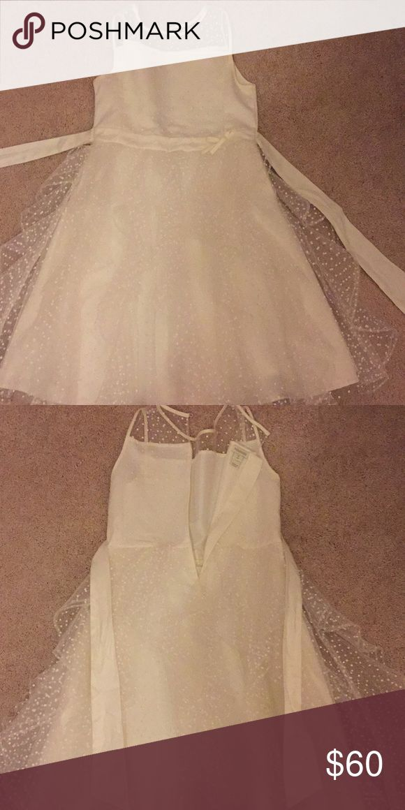 White Monsoon brand dress This beautiful monsoon dress was worn just once and is very good condition. It is the perfect dress to wear to a wedding, an event of any kind, or if you're just feeling fancy. This dress is perfect for little girls wanting to feel like a modern princess Monsoon Dresses Midi