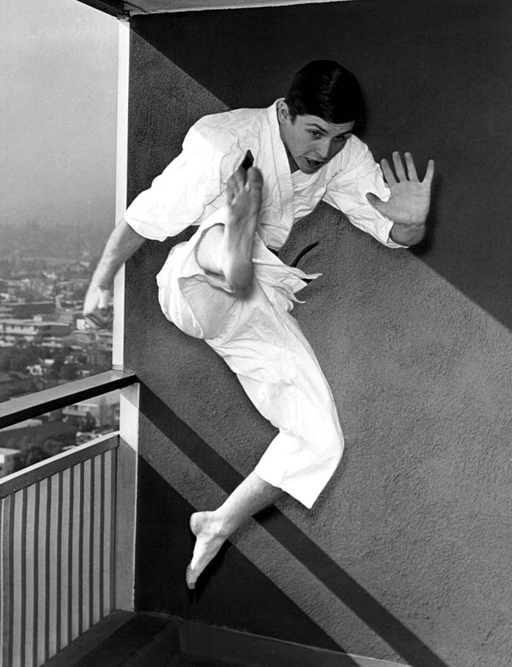 Burt Ward practices his karate moves on the balcony of his West Los Angeles apartment in February 1966, a month after the premiere of 'Batman'