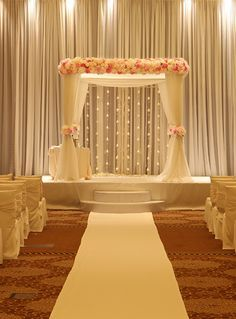 Like flowers on the top and on the sides like this, but colours of flowers to match the wedding theme