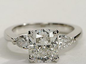 Exceptionally crafted, this diamond engagement ring showcases two beautifully matched pear-shaped diamonds prong-set in platinum to frame your center diamond. 1/2 carat total diamond weight.  Gorgeous!