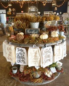 Idea to add hooks to front of craft fair table to hang product. Just don't over do it or it can become cluttered and overwhelming