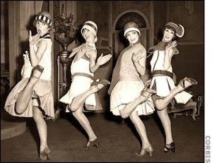 "This is an image of ""flappers"" doing the Charleston in 1924. This was a popular dance during this point in time. Pop culture- the Charleston became a common dance among young men and women in the 1920s. People were having a good time going to clubs and drinking alcohol, shopping and living the ""high life"". Also, the 1920s was known as the ""jazz age"" gramophones often played jazz music that was what people did the Charleston dance to."