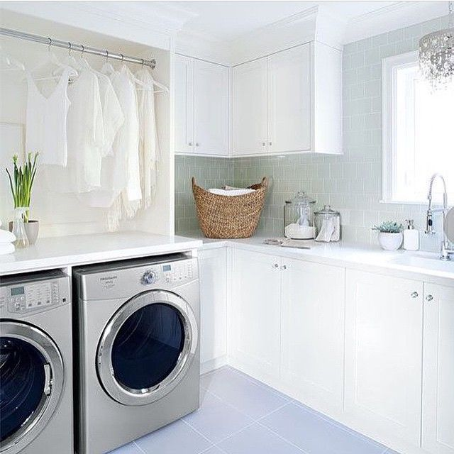 #tbt | This laundry room has it all - space for storing, hanging space, folding. Plus it's window and light colour pallet makes it a cheerful room to work in.