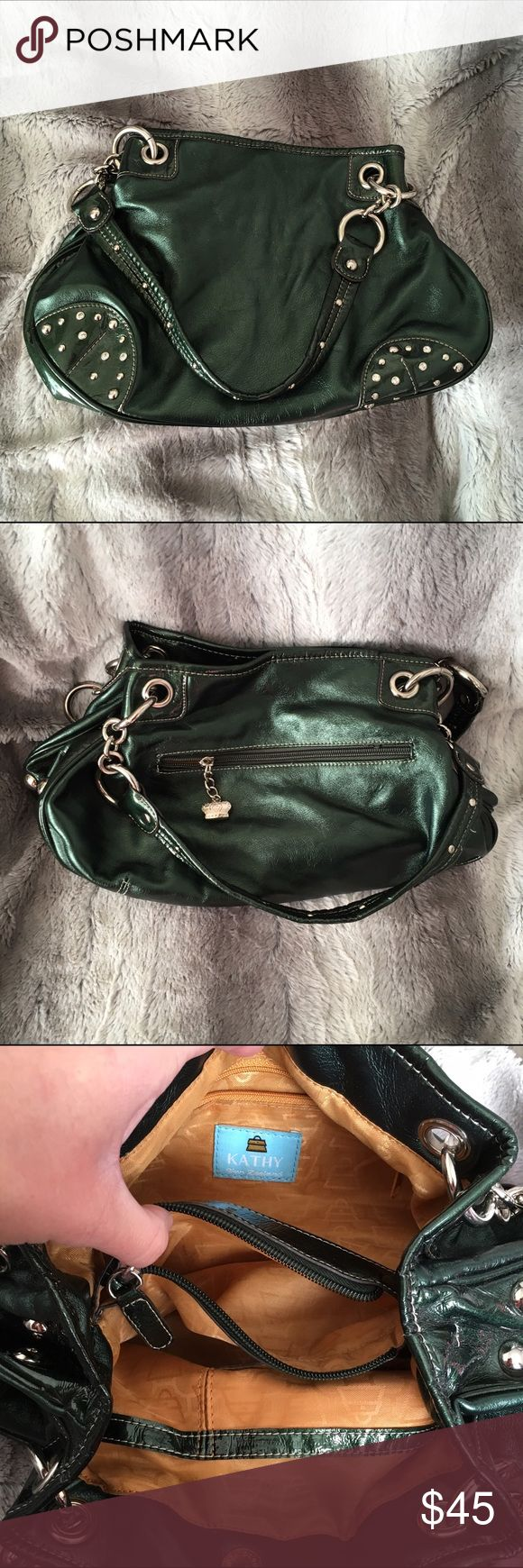 Emerald green Kathy Van Zeeland purse Amazing Emerald green Kathy Van Zeeland purse!! Great colour! Awesome style!! Has three pockets~ the center one has a zipper, the others have snaps! Good gently used condition! Some light wear here and there. Trying to downsize my purse collection!! Kathy Van Zeeland Bags