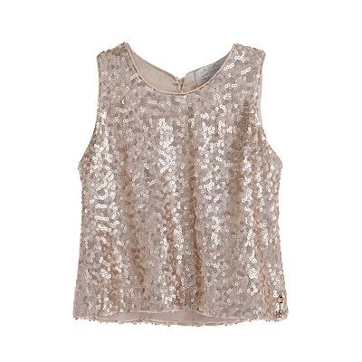 Sequin Vest. A simple matte effect gold sequin vest that will add resplendence to any outfit. Wear with matching sequin skirt to complete the look. Outer: 80% Polyester, 20% Viscose. Lining: 96% Polyester, 4% Elastane. Dry Clean only.