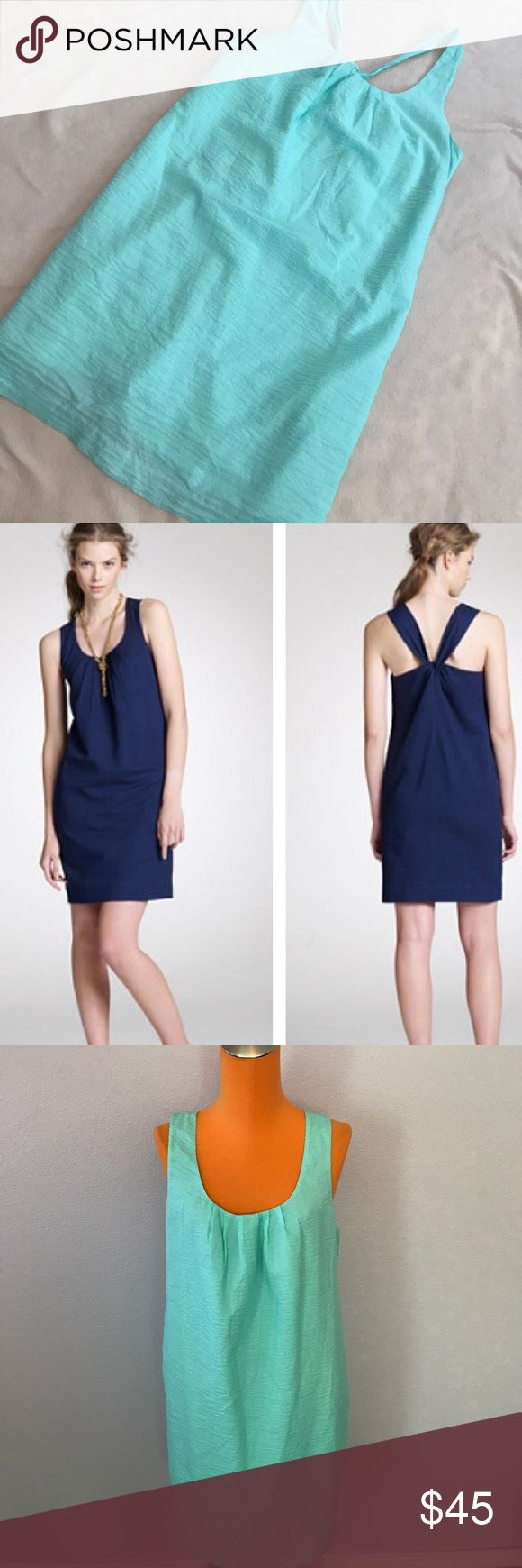 """J Crew Embossed Light Blue Playa Cross Back Dress Light blue color. A Line Criss cross back. Lightweight material. Lined on inside. Sundress. 35"""" length 18"""" armpit to armpit. Model is wearing same style just different color. Excellent condition. Bundle 2+ items for a discount J. Crew Dresses Midi"""
