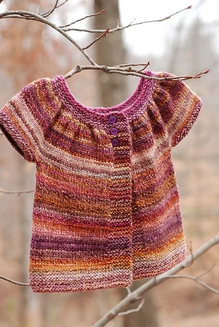 handspun baby sweater- made by: http://www.ravelry.com/people/CatReading pattern: http://www.ravelry.com/patterns/library/baby-kina