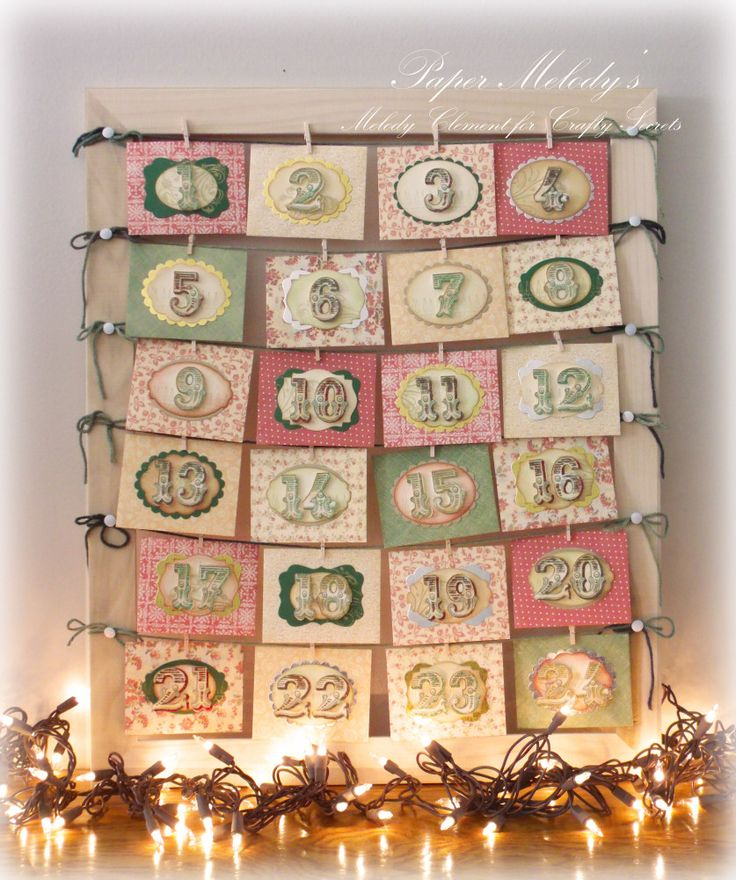 Advent Calendar Tutorial by Melody Clement showing how she used the big printable numbers from Crafty Secrets Vintage Christmas CD and die cut them with her Silhouette machine to go on 24 little envelopes and gives all the sizing and details for creating the cute envelopes.