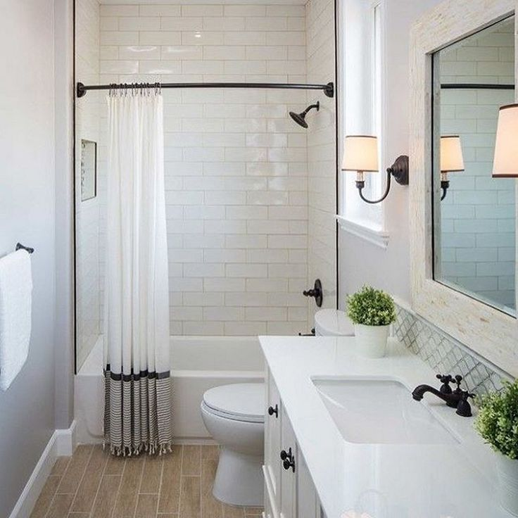 Contemporary design on a budget. The shower curtain rod is an integral part of this striking first impression