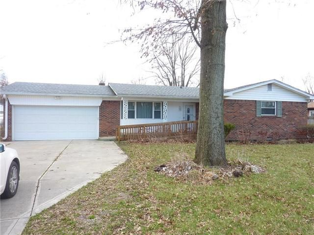 Sprawling all brick ranch with formal front living room and Large Family Room with Fireplace open to kitchen and patio doors to back yard. Home appears to have had some updates at some point but it being sold AS-IS. 3 Bedrooms and 2 full baths. Home has over half acre within minutes of shopping and schools   Property tax amount is guess with no exemptions