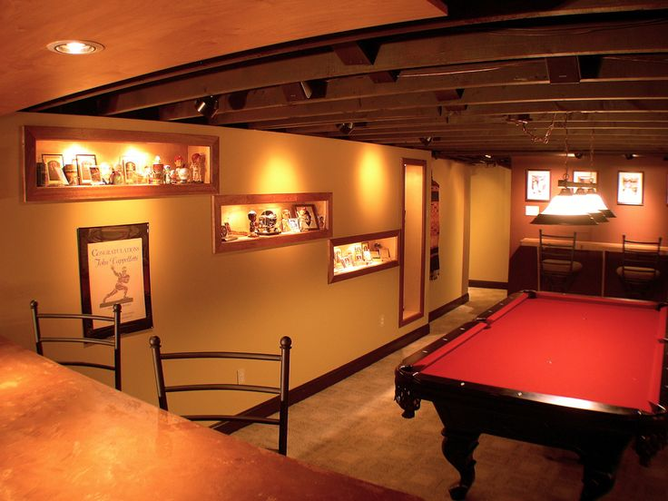 This man cave features a pool table and bar surrounded by for Man cave design ideas