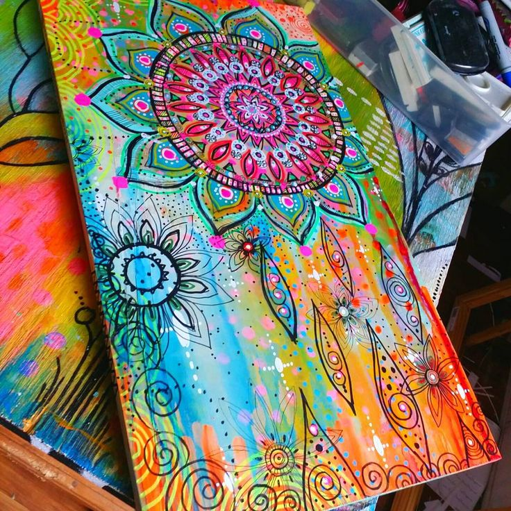 Trying out a little #BoHo style art on wood panel...using #goldenacrylics #drphmartins concentrated watercolor @sakuraofamerica #mysakurastudio pigmented pens..this is 12 x 20 very smooth plywood..first i used my golden acrylics with a brayer..then dripped the liquid watercolor and let dry..then doodled designs in pigment ink..and spray with sealant