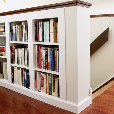 bookcase built into stairway half wall