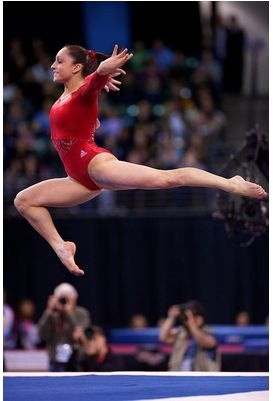 Jordyn Wieber's stag jump out of a tumbling pass on the floor exercise during the 2012 Kellogg's Pacific Rim gymnastics meet.  Jordyn won the senior all-around competition in a landslide for the U.S.  (Photo by John Cheng)