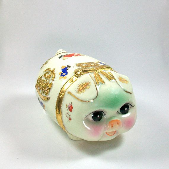 This little piggy is for sale! The piggys story is this... A friend of mine purchased her in the early 1990s from an asian vendor at the county
