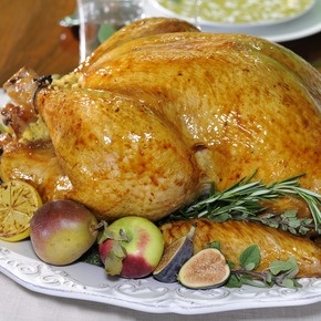 Michael Symon's Juicy Turkey Cooked in Cheese Cloth    (I want to try this next year, but note to self: I always cook poultry with great success by preheating to 500F then turning down to 325F when putting the bird in the oven. 10-13 minutes per pound - WATCH THE THERMOMETER. Should rest turkey at 160F)