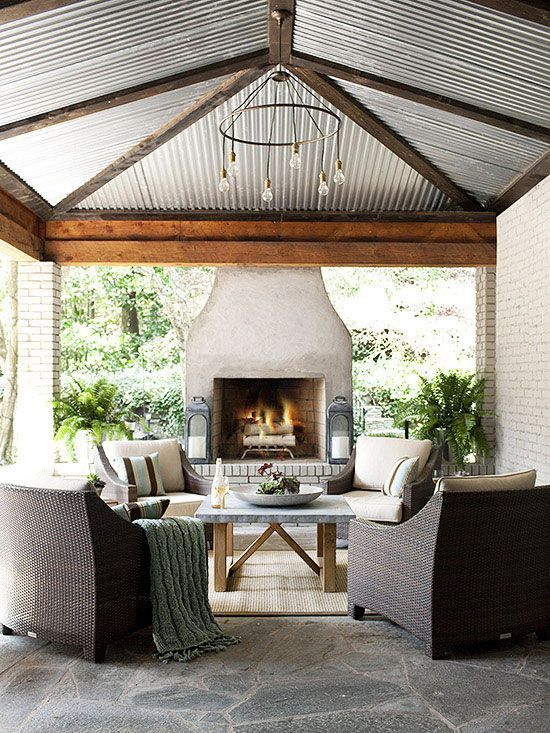 corrugated metal ceiling is one to keep in mind for a screened in pergola space. Outdoor fireplace, stone floor.