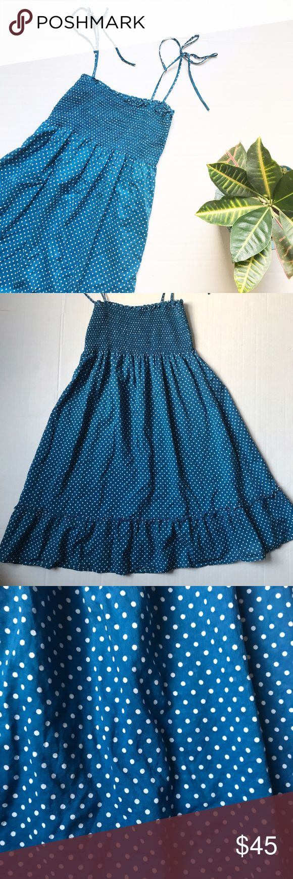 J. Crew Smocked Top Polka Dot Dress Smocked top Polka Dot dress from J. Crew. Size: M. Color: Blue and white. Smocked top with tie straps and ruffle bottom. 100% cotton. Length: 35 inches long. J. Crew Dresses