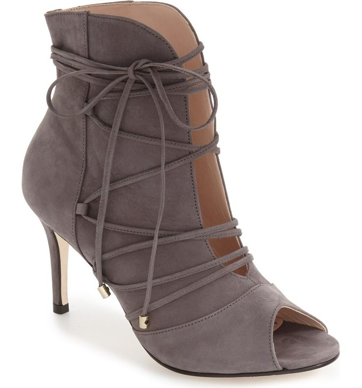 This peep-toe bootie set on a stiletto heel and wrapped with slim straps provides a sophisticated addition to the street style.