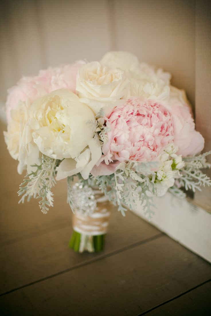 Some seriously lush blooms from Florals by the Sea. Photography: Woodland Fields Photography - www.woodlandfieldsphotography.com, Floral Design: Florals by the Sea - www.floralsbythesea.com  Read More: http://www.stylemepretty.com/2014/07/24/shabby-chic-coastal-wedding/