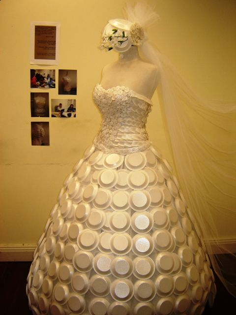 Surprising...dress made of condoms and cardboard plates.
