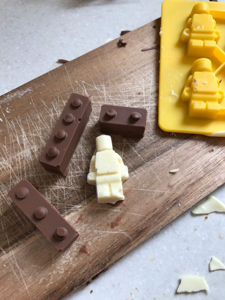 Ideas for Lego party bag, These cute little chocolate Lego bricks and chocolate Lego men would be perfect for a Lego treat bag - click through for loads of Lego Ninjago Party Ideas and much more #LegoParty