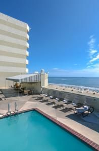 Featuring a rooftop pool and restaurant overlooking the Atlantic Ocean, every room at this modern hotel on the Virginia Beach boardwalk offers a private...